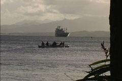 Canoes and ship Suva Fiji Stock Footage