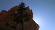 Sun breaks over rock, time lapse Stock Footage