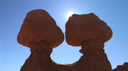 Sun peeks behind rock formations, time lapse Stock Footage