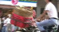 Stock Video Footage of China Hong Kong Biker delivery streetscene