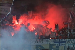 soccer fans with alight the torches at the stadium - stock footage