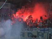 Soccer fans with alight the torches at the stadium Stock Footage