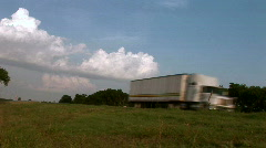 Large Cargo Trucks Travel Down Highway Stock Footage