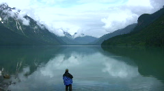 Pristine Chilkat lake with a fisherman Stock Footage