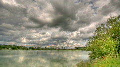 HDR time lapse of clouds over lake - stock footage