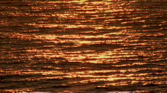 Bronze & Gold Ocean Surface Reflecting Sunrise - Waves Stock Footage