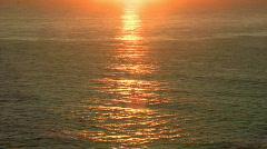 Orange Sunrise Reflecting on Ocean Waves - Sunset Stock Footage