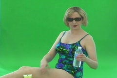 Lovely Young Blonde in One-piece Swimsuit Stock Footage
