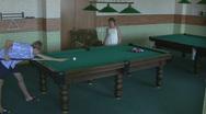 Boy and girl playing pool Stock Footage