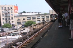 ELEVATED TRAIN PULLS INTO STATION Stock Footage
