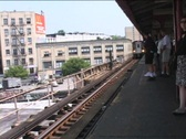 Stock Video Footage of ELEVATED TRAIN PULLS INTO STATION