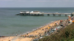 Pier and sandy beach at Cromer Norfolk England Stock Footage