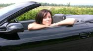 Beautiful Girl Sat In A Black Convertible Pontiac Firebird Sports Car Stock Footage