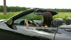 Pretty Young Woman Sat In Sports Car Puts On Sunglasses Stock Footage