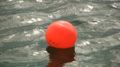 Bouy laying in calm water Stock Footage