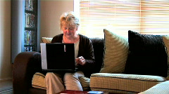 Senior lady using a laptop computer Stock Footage