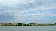 Clouds passing over river Stock Footage
