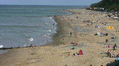 Holidaymakers on the beach at Cromer Norfolk England Stock Footage
