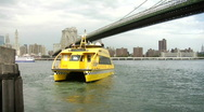Stock Video Footage of NYC Water Taxi & Brooklyn Bridge