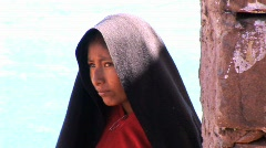 Peruvian girl with black scarf - stock footage