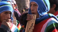 Peruvian boys play flutes - stock footage