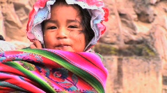 young Peruvian girl on mothers back  - stock footage