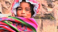 Stock Video Footage of young Peruvian girl on mothers back