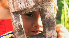 Peruvian boy looks through wood frame Stock Footage