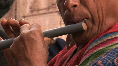 Peruvian man plays flute  - stock footage