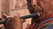 Peruvian man plays flute  Stock Footage