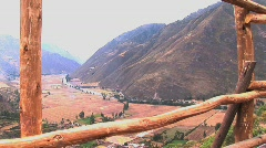 Wood fence with mountain and valley below in Peru Stock Footage