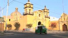 Tuk tuks pass by church  Stock Footage