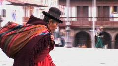 Old indigenous woman walks in Peru Stock Footage