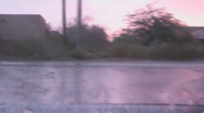 Time lapse speed driving rain pink sunset clouds Stock Footage