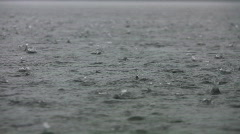 Heavy rain on the lake. w/ sound of thunder. - stock footage