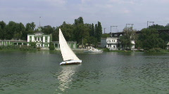 Sailing boat floats on the river. Stock Footage