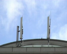 Mobile phone masts on building  Stock Footage