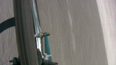 HD bike wheel on road Stock Footage