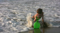HD boy playing at the beach Stock Footage