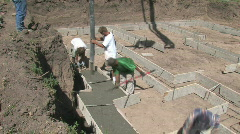 Concrete into footings fast M HD - stock footage