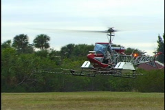 Crop Dusting AG Helicopter Landing In Field Stock Footage
