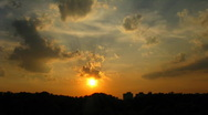 Sunset through the many layers of clouds Stock Footage