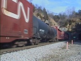 Train out of tunnel Stock Footage