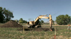 Excavator backhoe working new home foundation M HD Stock Footage