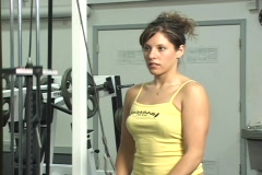 Attractive young woman in a gym weight lifting Stock Footage