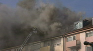 Building House Fire Smoke Flames Burning - Firefighter Tackles Blaze With A Hose Stock Footage