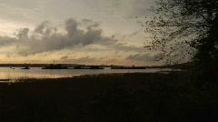 Shipwrecks and sunset pan Stock Footage