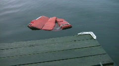 Lifejacket floats near dock. - stock footage