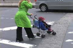 WOMAN PUSHES STROLLER  - stock footage