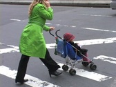 Stock Video Footage of WOMAN PUSHES STROLLER